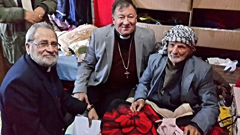 Dr. Nuhad Tomeh and Rev. Haitham Jazrawi with a 104 year-old man displaced from his village to Akre