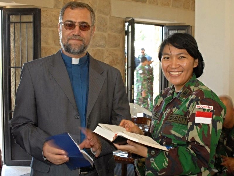 Rev. Fouad Antoun, after worship in Marjayoun, with a UN peacekeeper from Indonesia