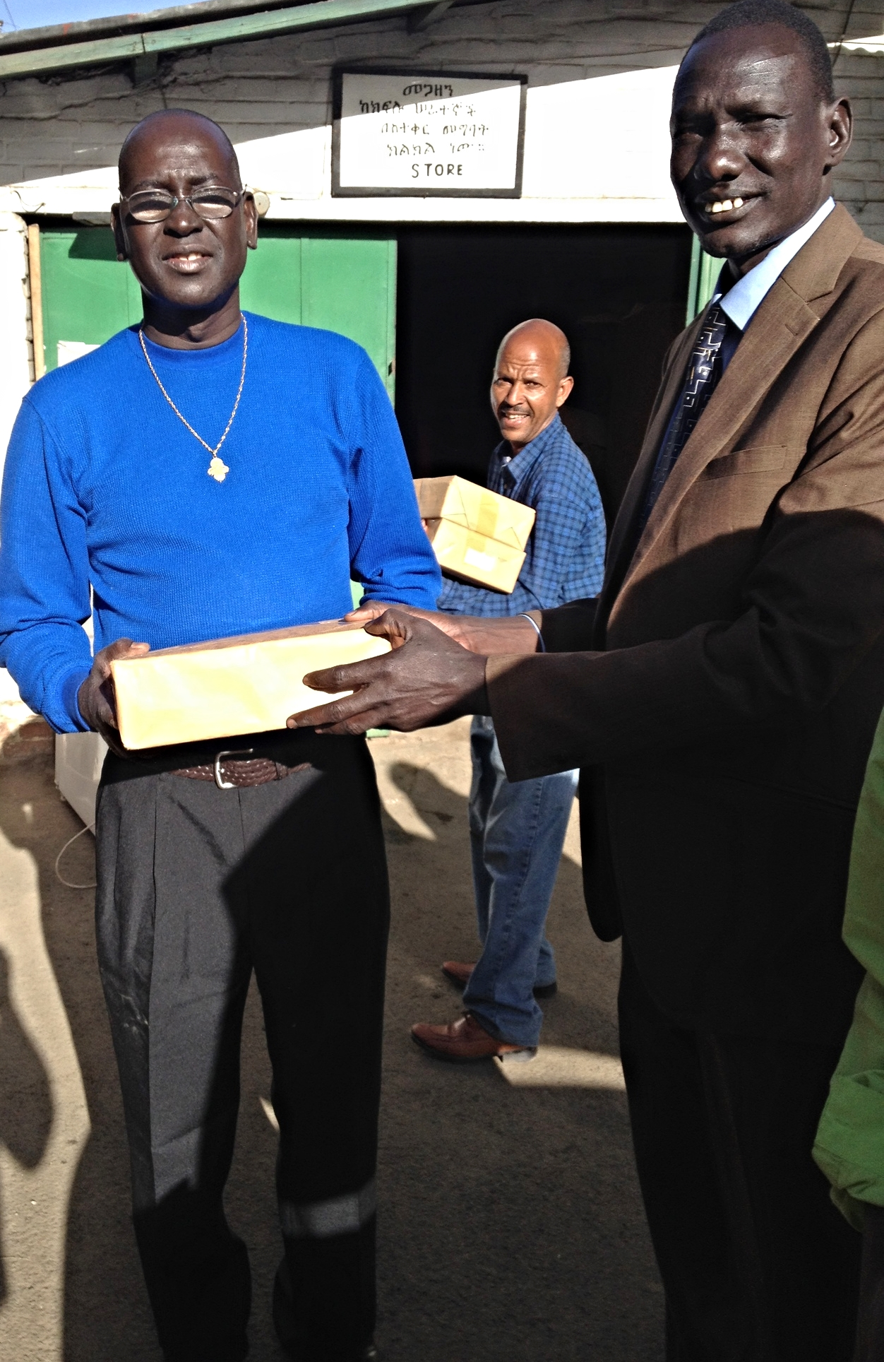 David Paduil and the Rev. Nhial loading hymnals to take to Gambella.