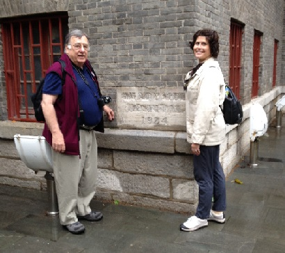 Art Gilkes and Linda Leach from Shadyside Church stand at the cornerstone of namesake Shadyside Hospital in Weifang, Shandong