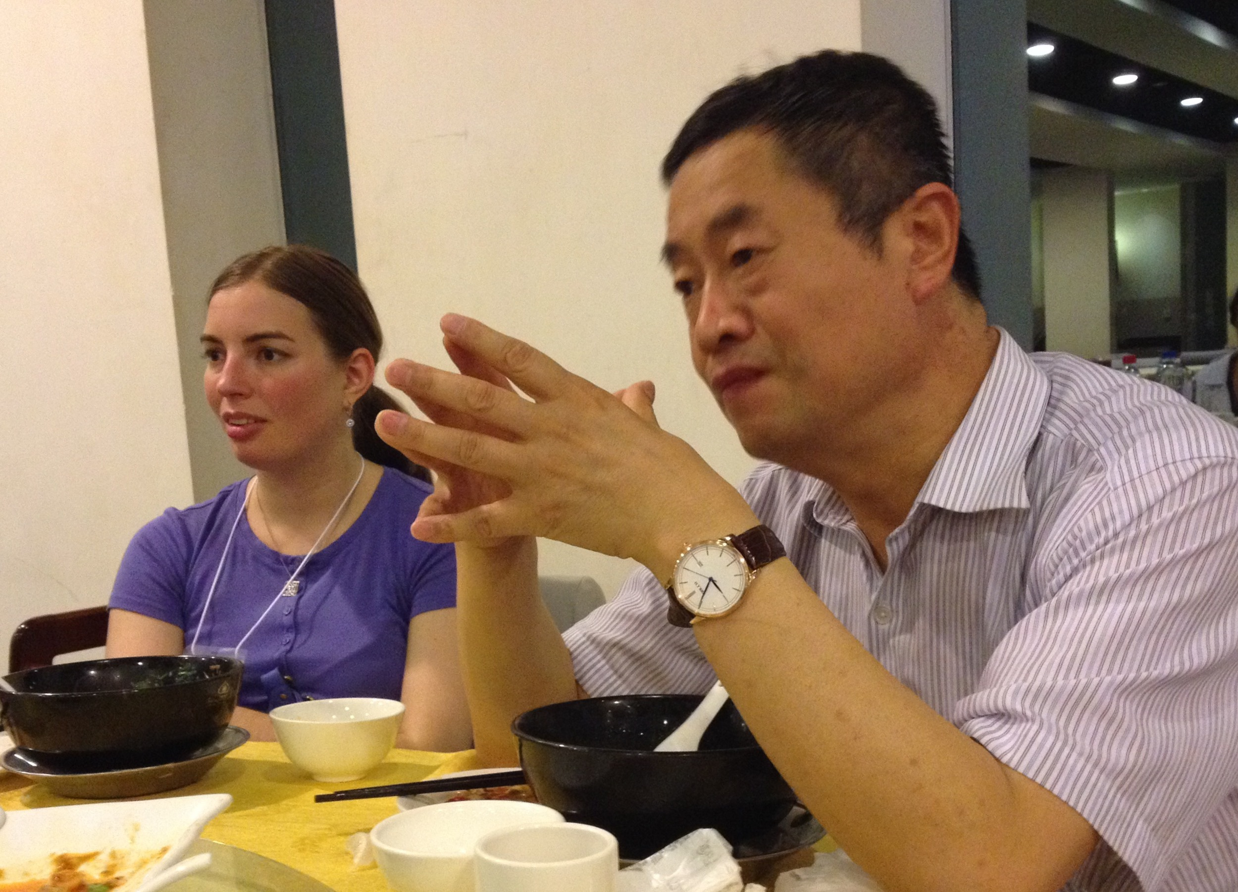 Trip participant Julie Richards  meets with Brother Wei in Xi'an, home of the Terracotta Warriors