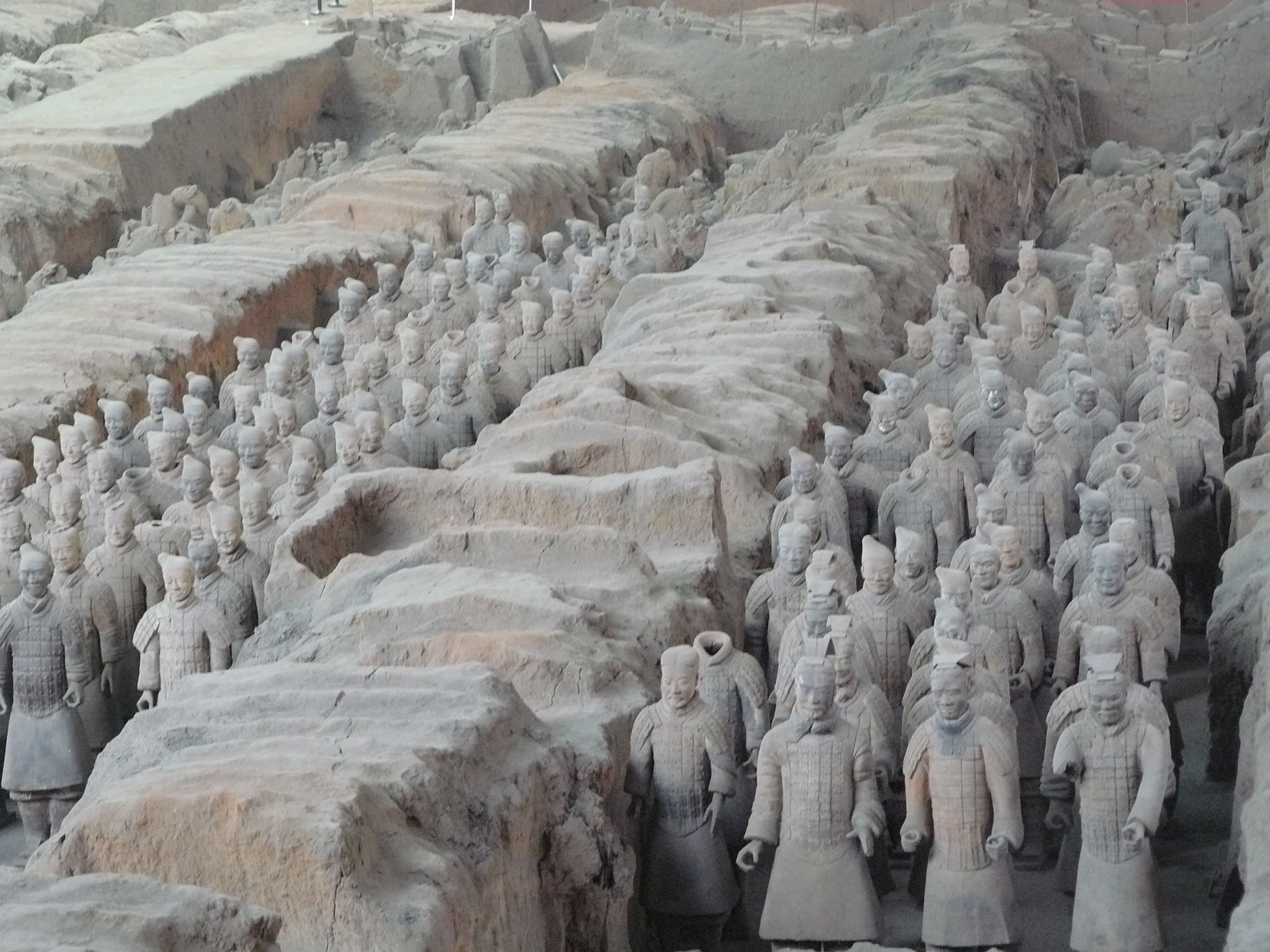 Ancient life-size terracotta warriors lined up to protect the emperor