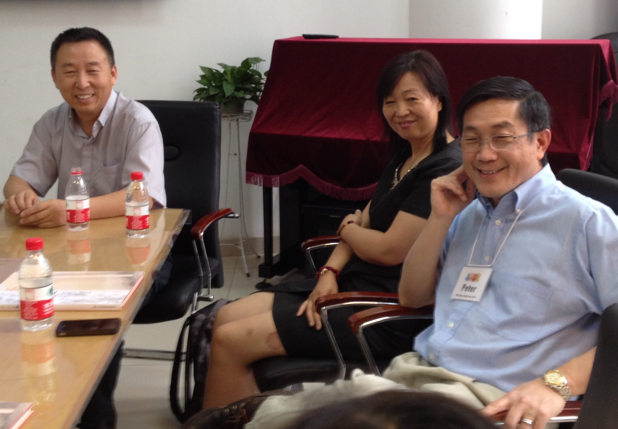 Pastor Wu (left) and his wife, Pastor Ruth, greet Outreach's Dr. Peter Lim