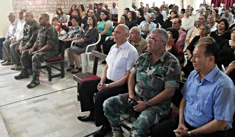 The congregation of Mhardeh gathers for worship. Some of its members are serving in the local National Guard.