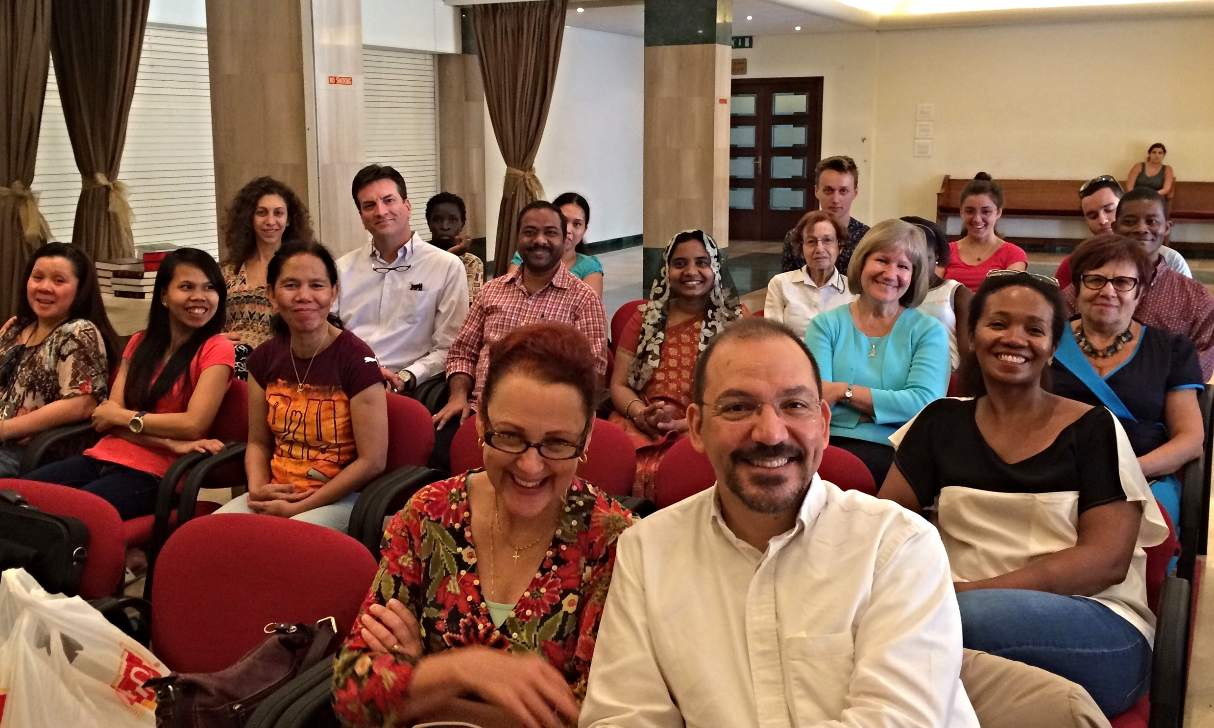Rev. Robert Hamd and his wife Joyce in the front row this morning with worshipers in the international church gathering.