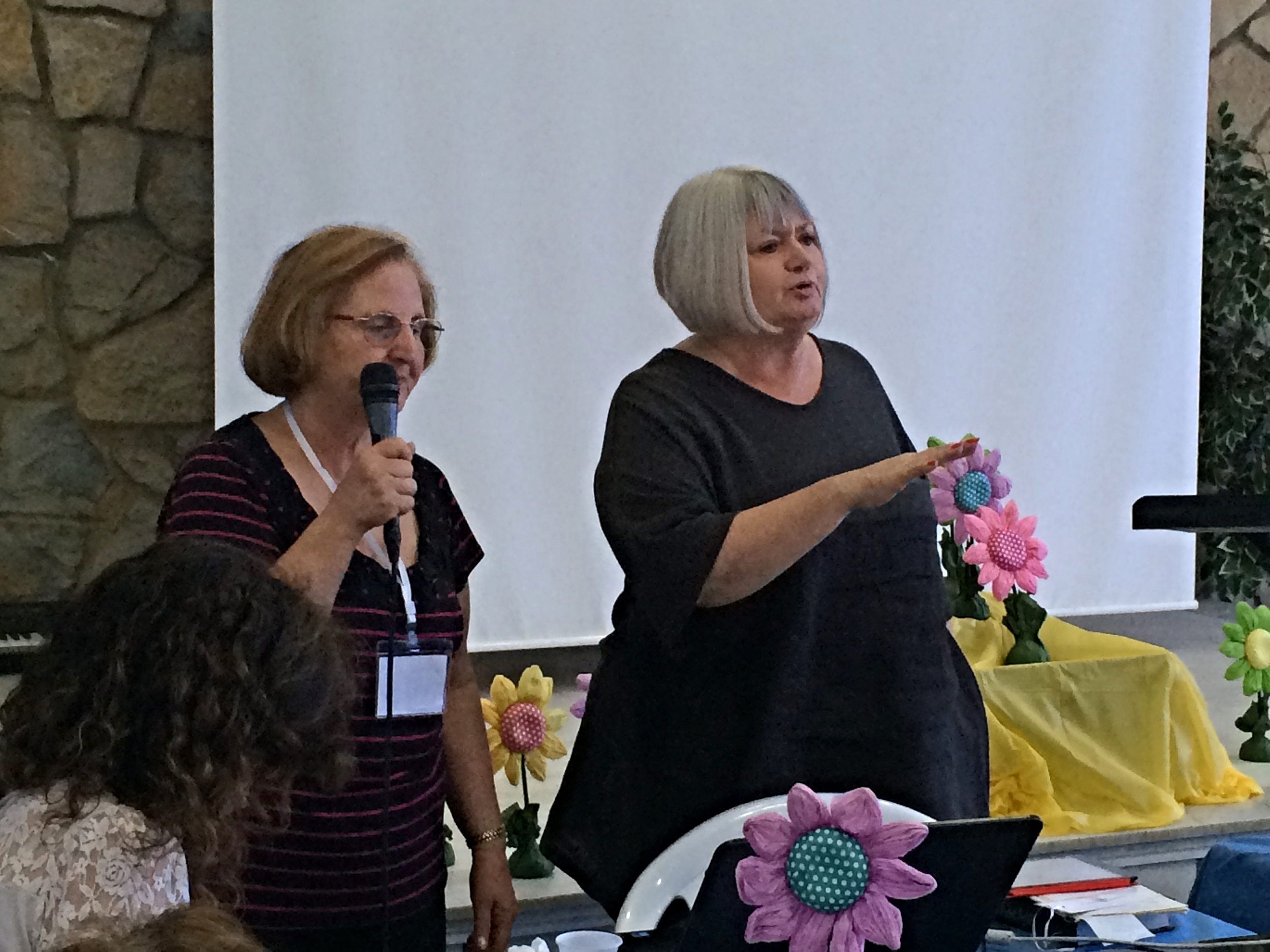 Dr. Mary Mikhael translates for our Arabic speaking sisters as Marilyn leads us in the story of the woman at the well.