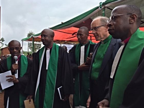 Rob and Rwandan pastors preparing to cut the ribbon and enter the Karangara Church