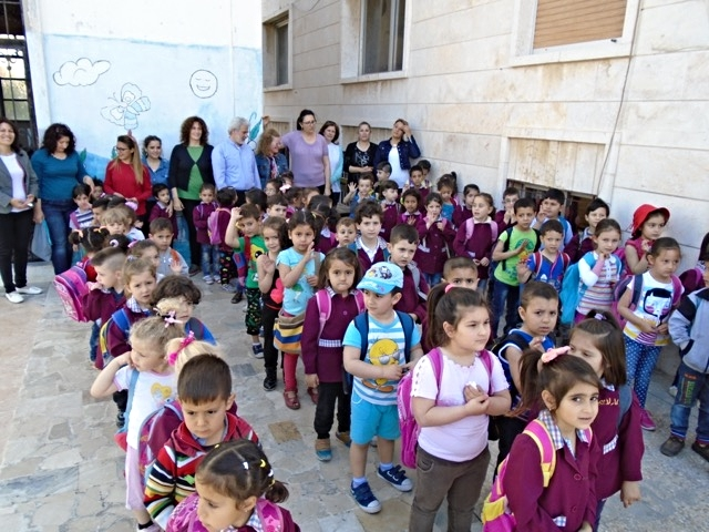 The children, teachers and staff of the Mahardeh kindergarten line up to greet us. The ones on the far right are the five year-olds and they will graduate in May.