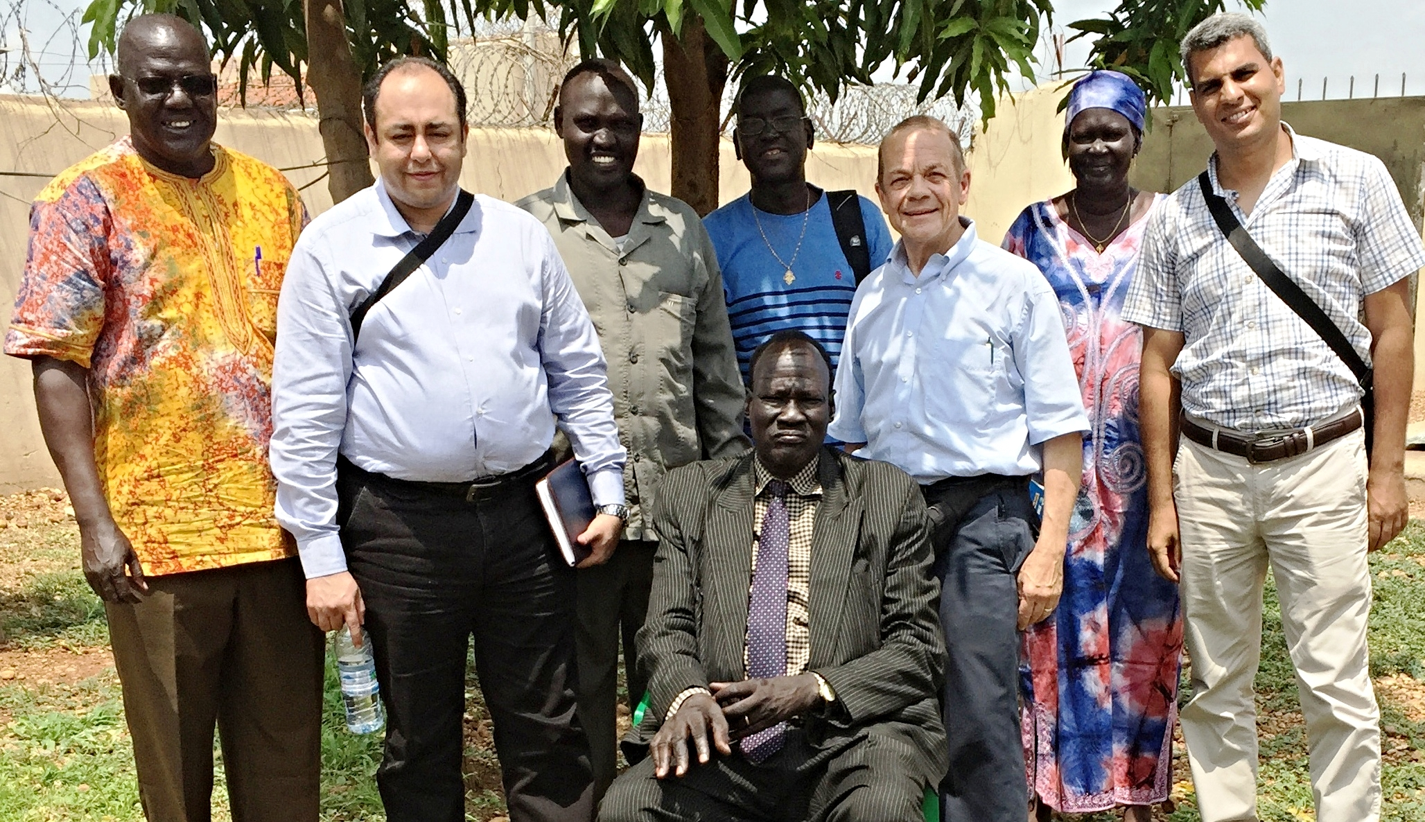 The photo of the leadership of the South Sudan Presbyterian Evangelical Church with us includes, from left to right, Elder Daniel, Treasurer; (Hani Jack); Rev. Philip Obang, General Secretary; Rev. James Par Tap, Moderator, seated; (David Paduil behind); (Jeff); Madam Achol, Head of the Women's Desk; (Hany Bareh).