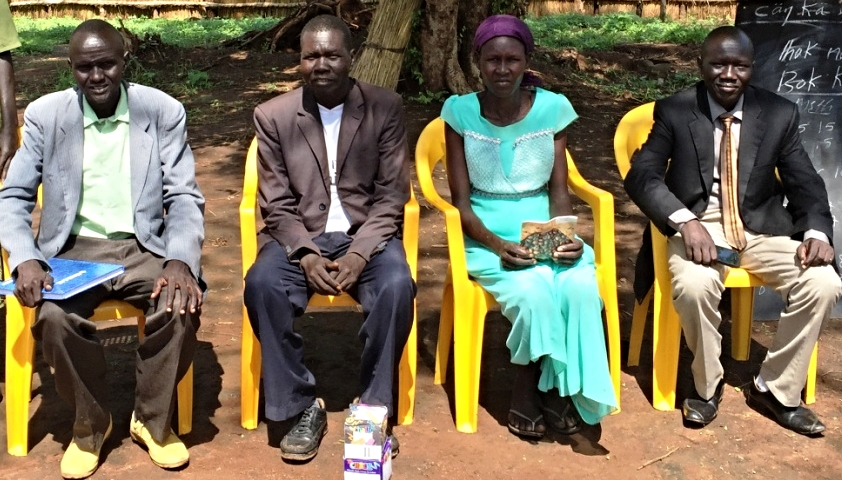 Teachers in Kule 1 parish school with John Jock far right