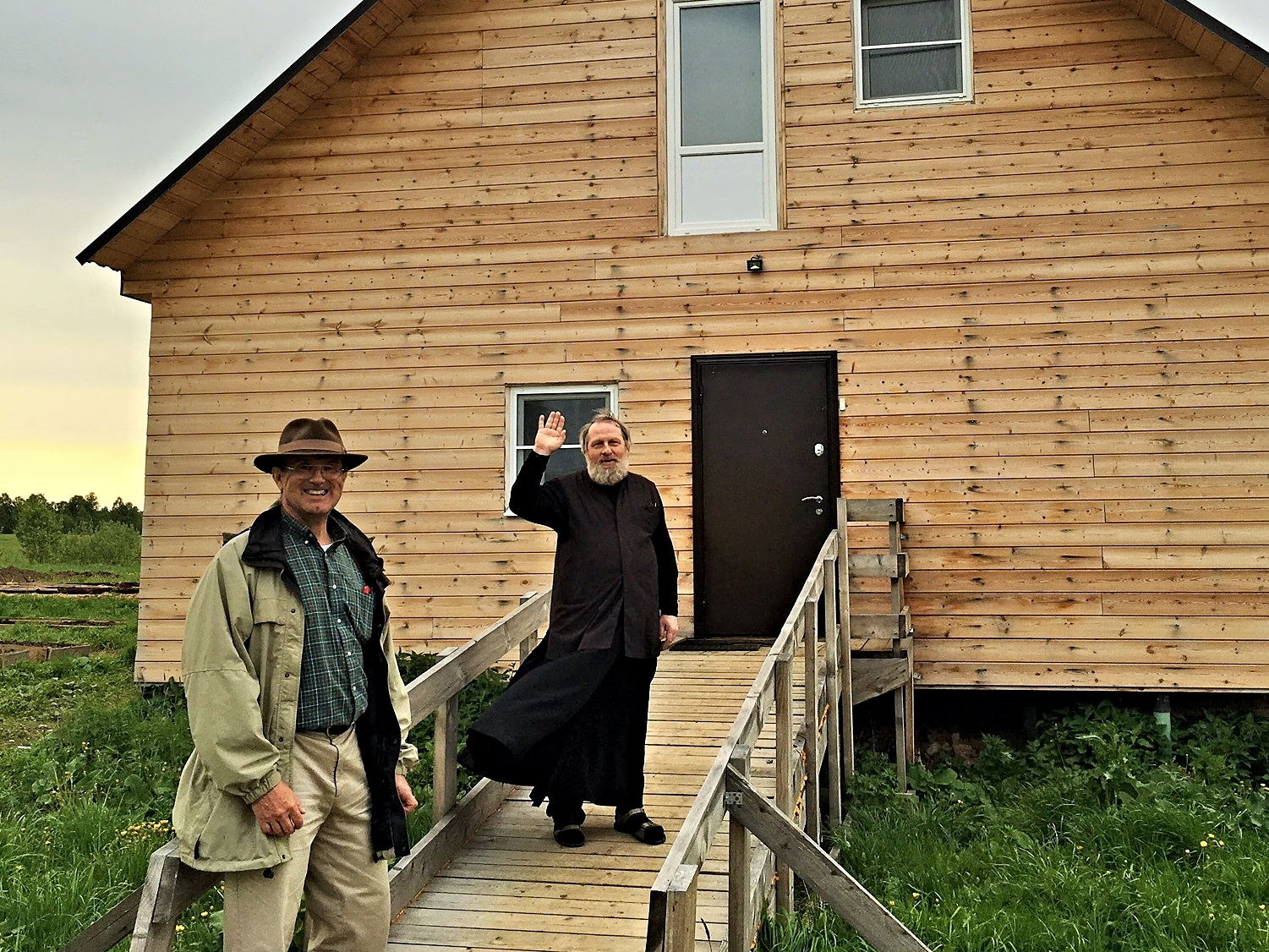 Al and Father Vladimir in front of the new dormitory