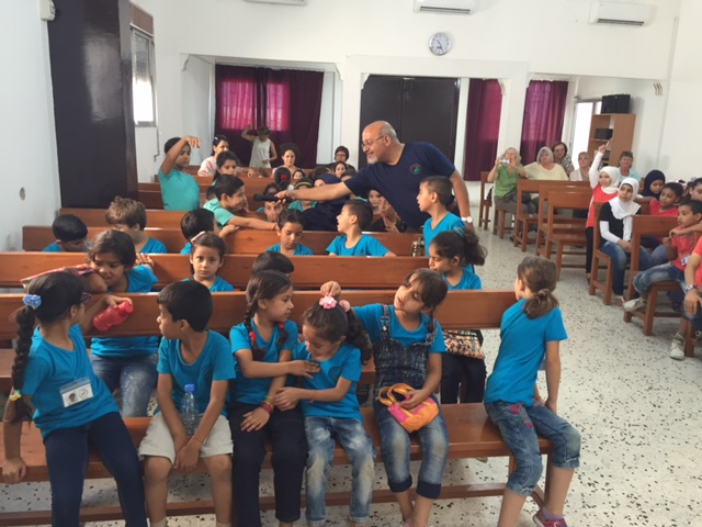 Rev. Amir engages the children in stories of the Bible