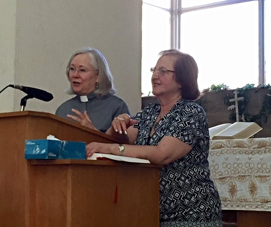 Rev. Dr. Nancy Fox preaching, with Dr. Mary Mary Mikhael translating