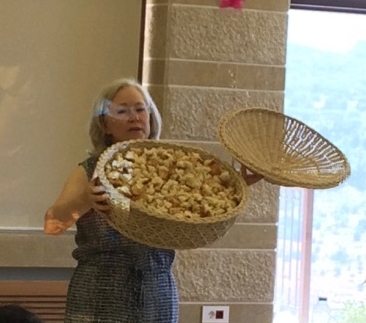 Rev. Nancy Fox and the basket of crumbs