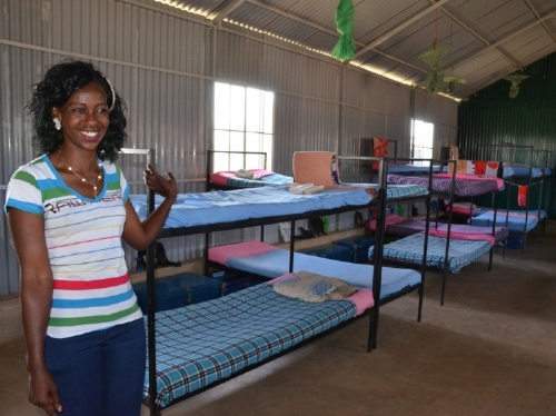 Beatrice, who runs the Center, is like a mother to these girls. She is pictured here in the girls' dormitory