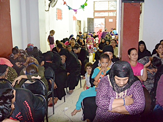 Women praying at their weekly women's meeting