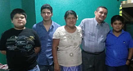 The Herrera Family. Three of their children have left the country to provide for the home.