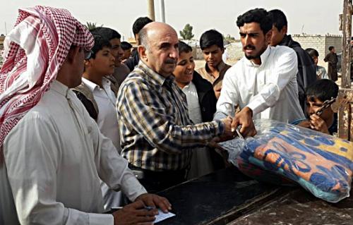 Elder Samir distributes blankets