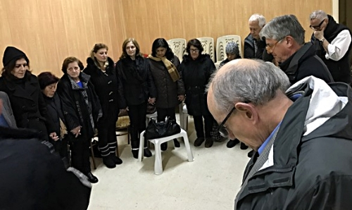 Praying with displaced famiiles in Yazdieh