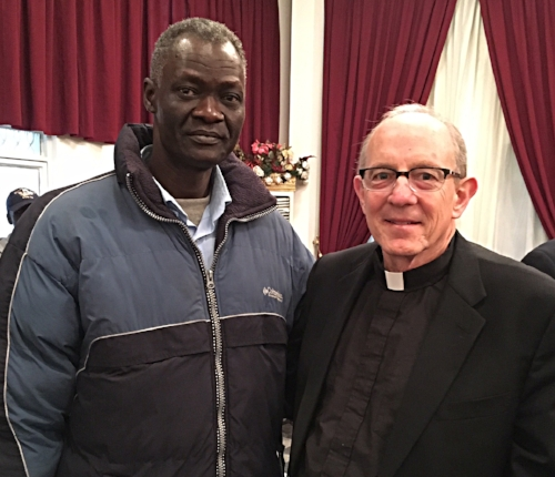 South Sudanese refugee Johnson George with Rev. Dr. Rob Weingartner