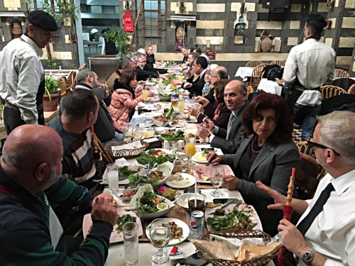 Damascene and American Presbyterians sharing food and fellowship at the Mona Lisa Restaurant