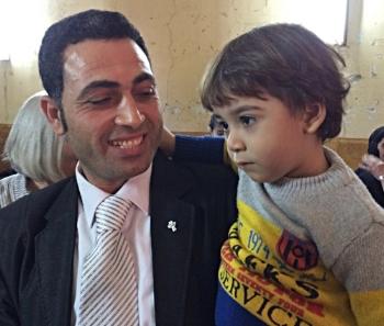 Rev. Shenouda at El Adaima with his son, Justin.