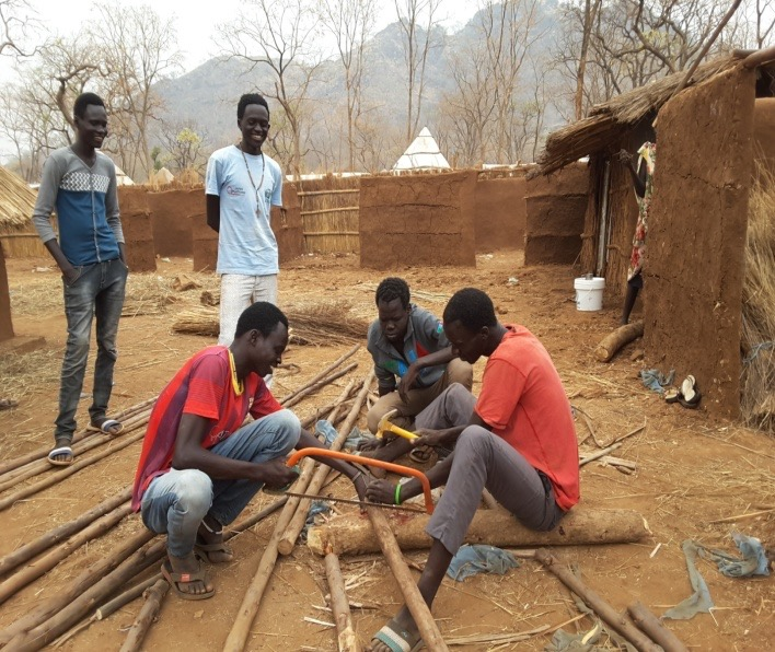Enthusiasm begets enthusiasm. Young refugees voluntarily building classrooms to protect students during the rainy season.