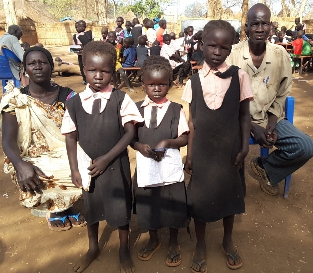 A family impacted by the schools in the refugee camps