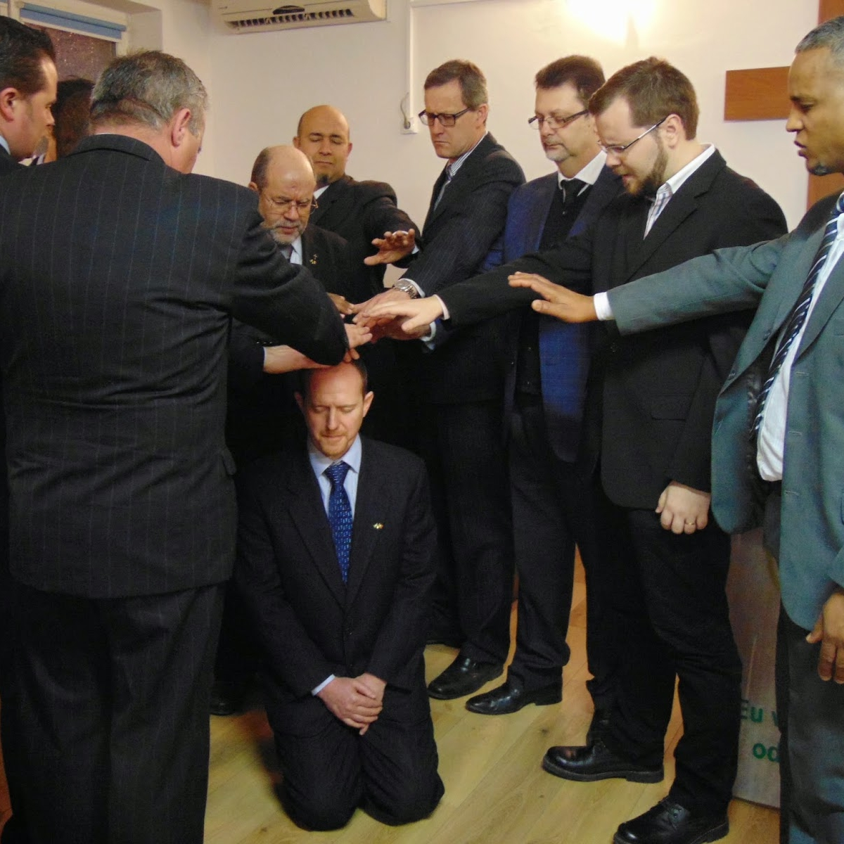 A pastor is ordained in Maganlia, Romania with pastors coming from Italy, Albania, Spain, and England.