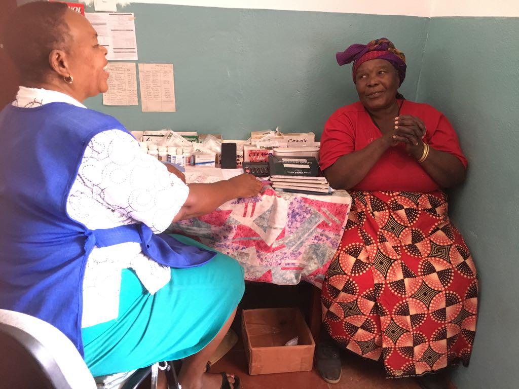 Nurse Rudia Mwela with a patient at the Namumu clinic