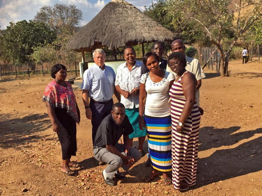 Namumu Board: Rev. Charles Ngoma (kneeling); standing from left: Loveness Musialike, Frank Dimmock, Rudia Mwela, Ivert Kameme, and Ebralie Mwizerwa; back row: Phanuel Simamba and Leonard Hachitapika