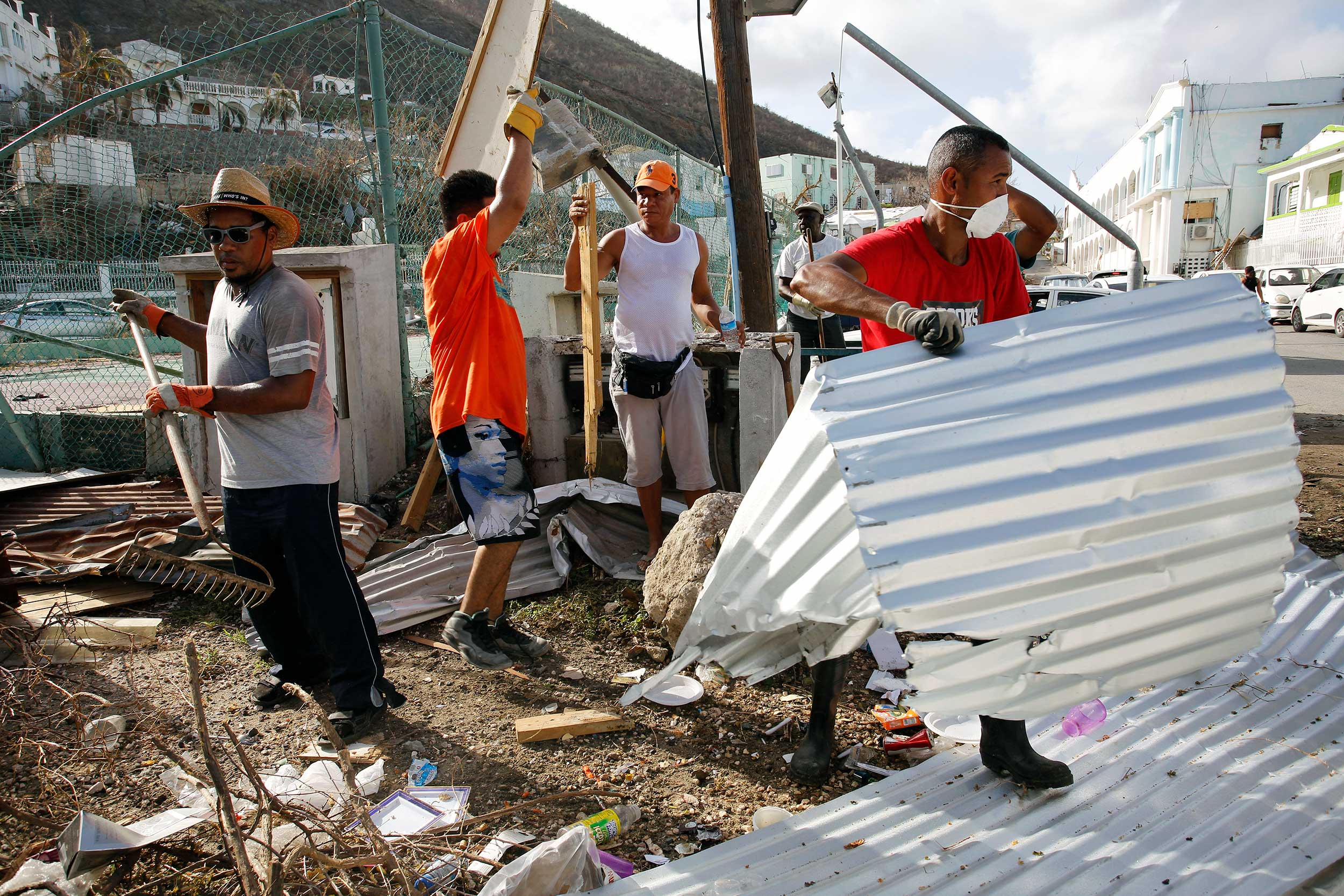 Workers clear debris on St Maarten ( photo by Arie Kievit for The Climate Centre )