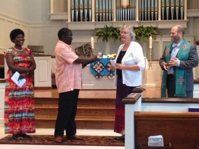 Rev. and Mrs. Nyondo receive a gift from EOP presented by Rev. Judy Henderson and Rev. James Estes