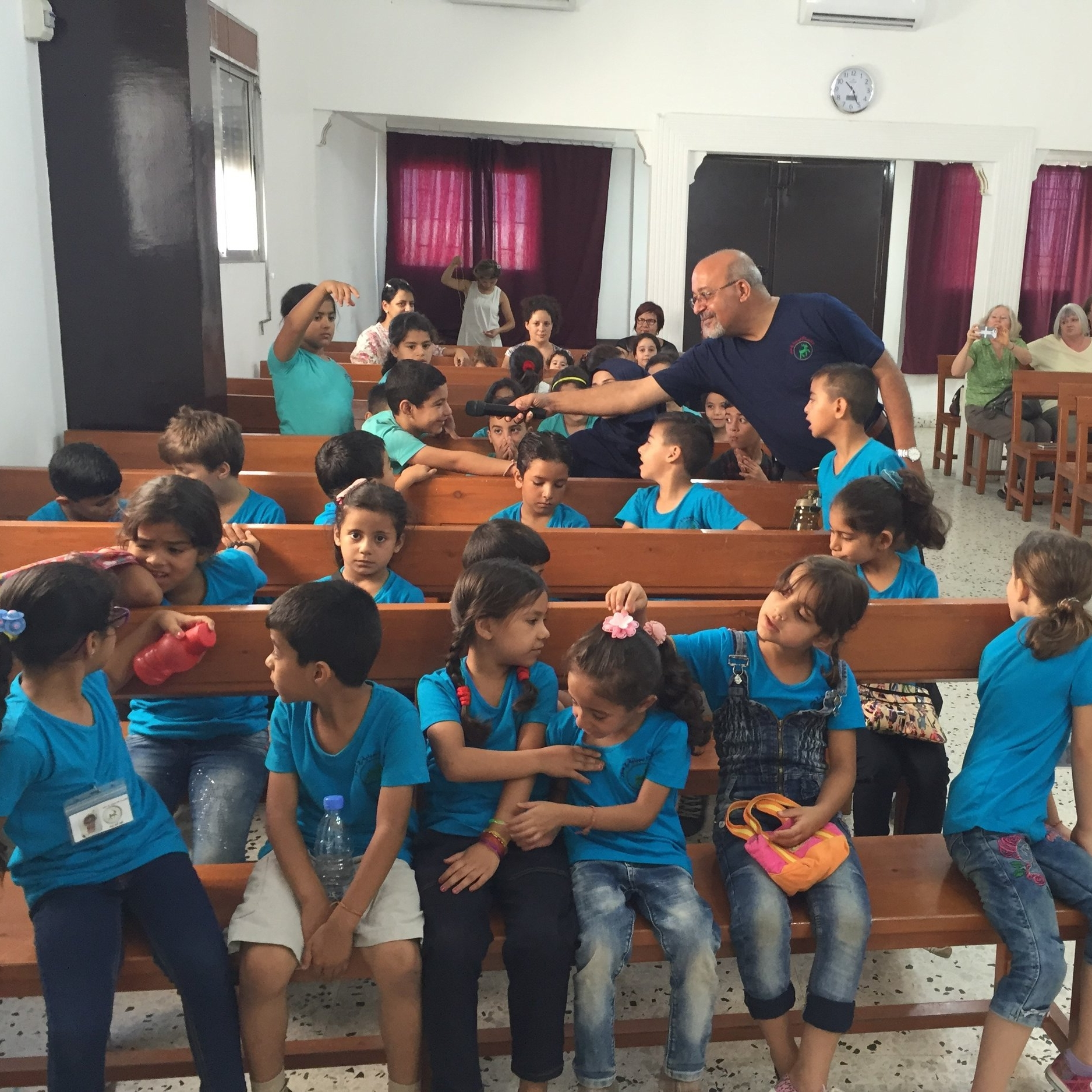 Syrian refugee children discussing a Bible story during chapel in Tyre.