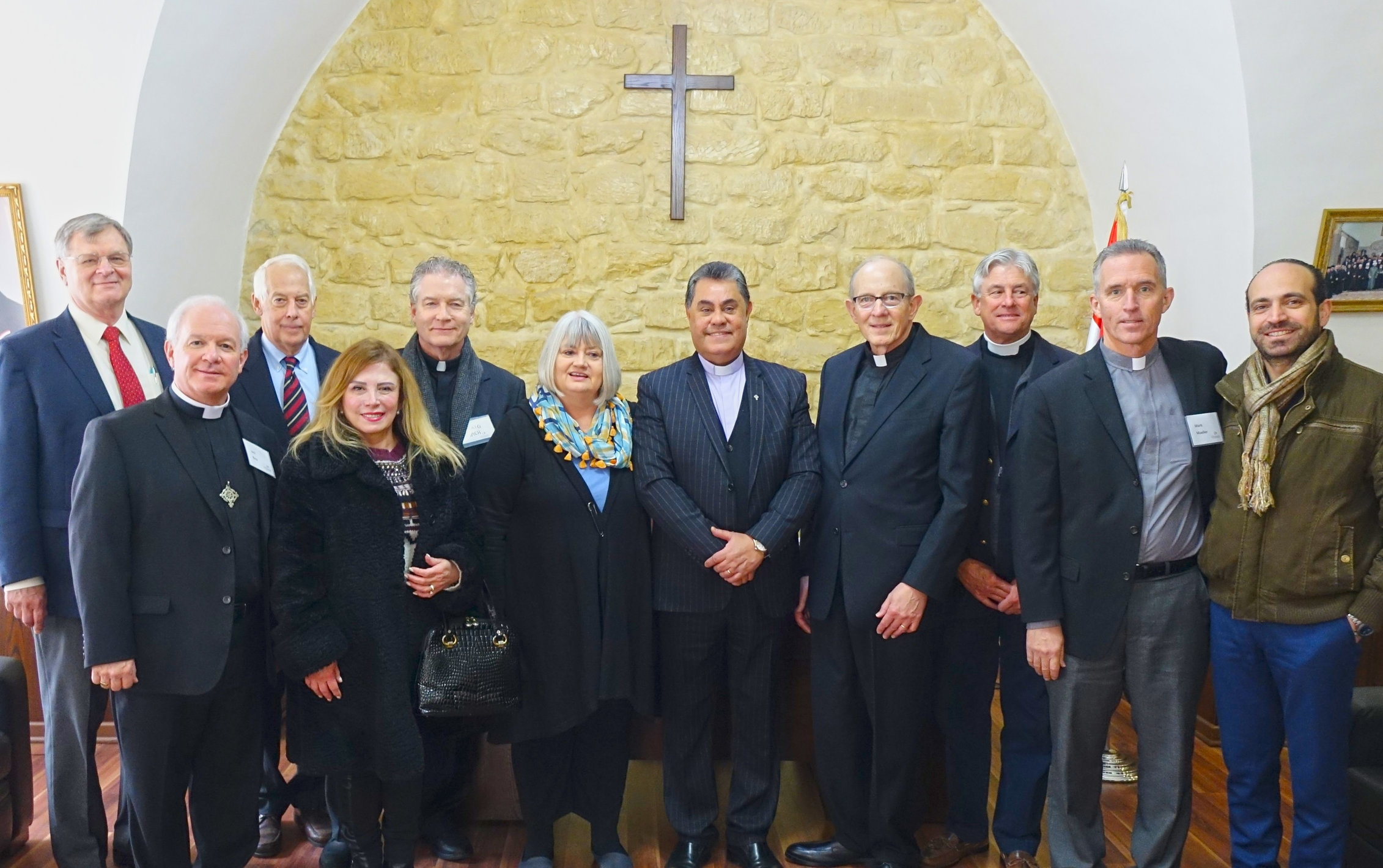Thanks to your act of love Rev. Boutros Zaour of Damascus, pictured in the middle with an Outreach team which visited his church in January, is starting repairs on a hole in the roof caused by a mortar that fell late on a Sunday afternoon.