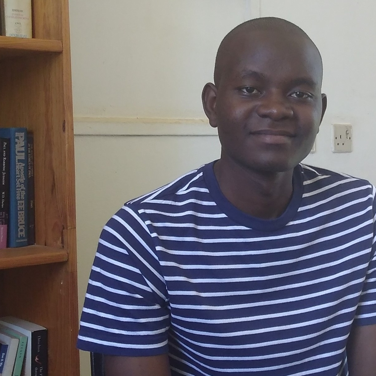 Watanga Ngoma in Dustin's office, sharing hopes and concerns about his upcoming ministry.