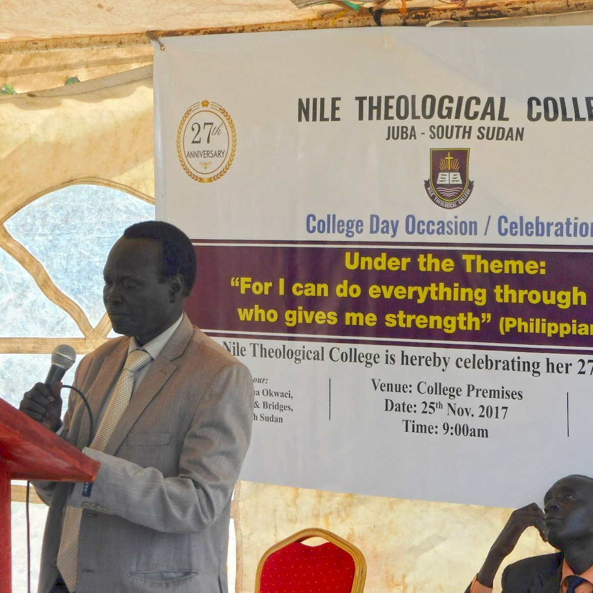 Rev. Santino, principal of Nile Theological College,  speaks at College Day.