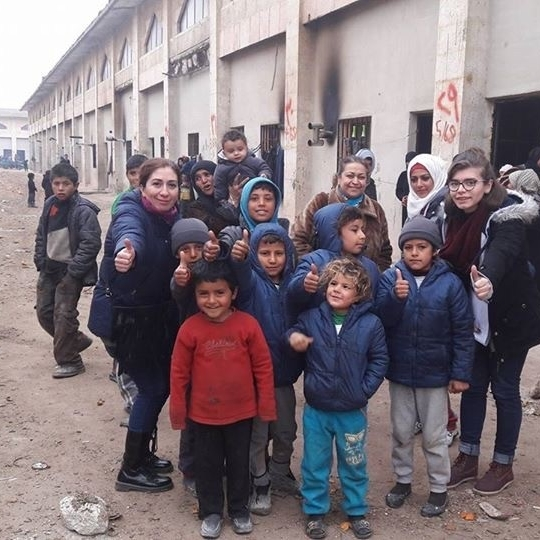 """Tami, far left, is Rev. Ibrahim's wife and has made multiple trips to the Jibreen """"shelter"""" with others from her congregation."""