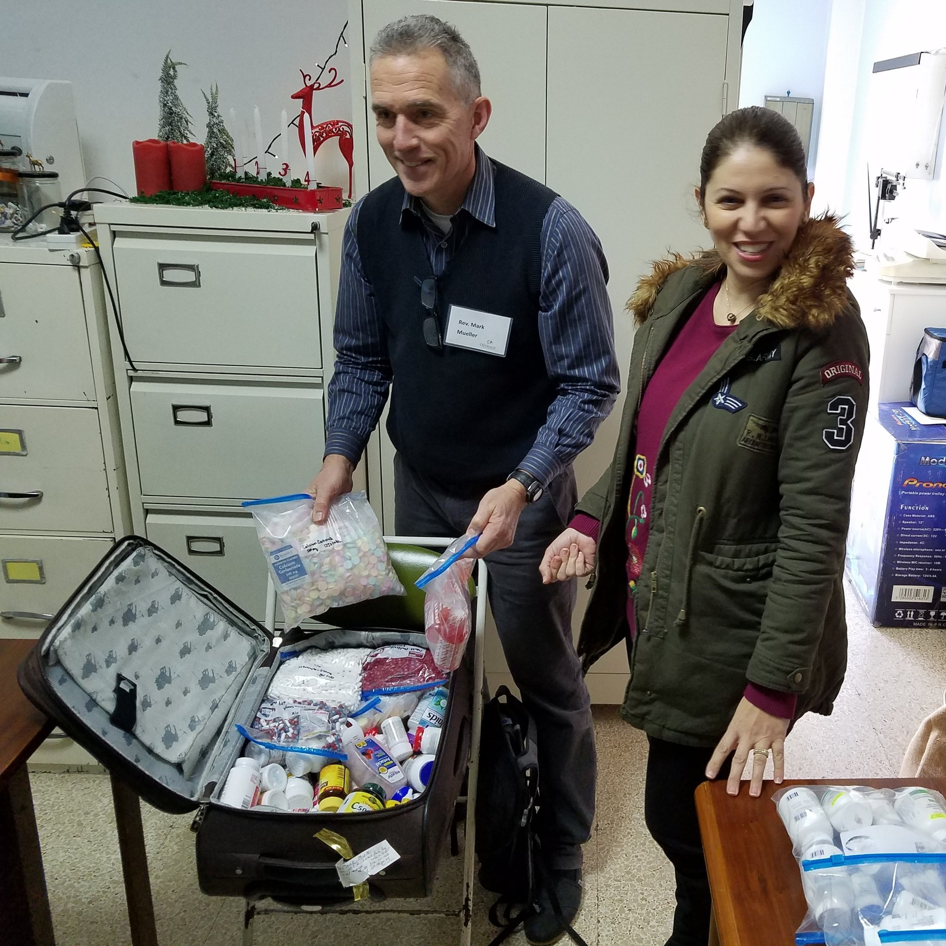 Mark, Grace and suitcase of medicines