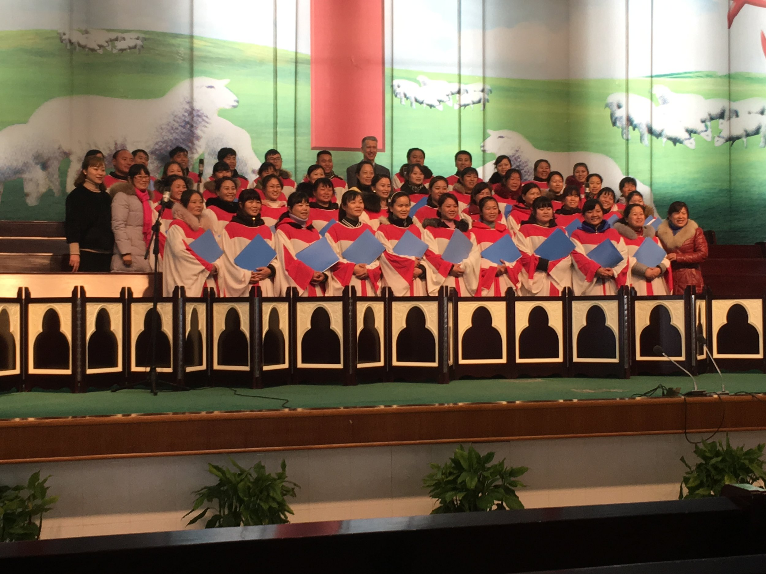 Standing in the back row, middle, with the choir