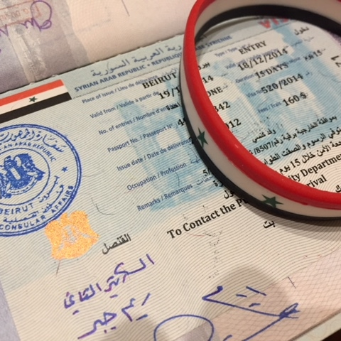 Visa from previous trip to Syria with Syrian flag bracelet, reminders of our longing