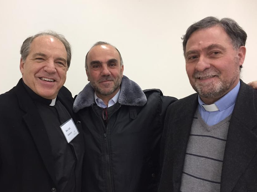 Jack Haberer (left) and Pastor Tony Abboud (right) embrace Tony's friend George (center)