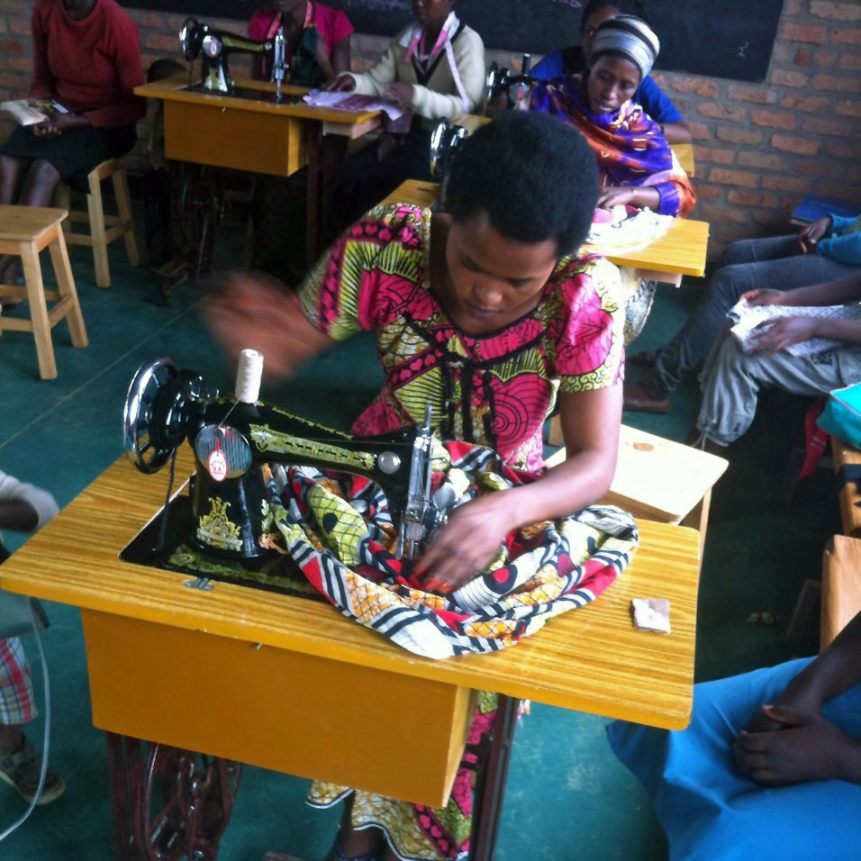 City-Evangelization-Busanza-Vocational-Training-School-March-2017-woman-sewing.jpg
