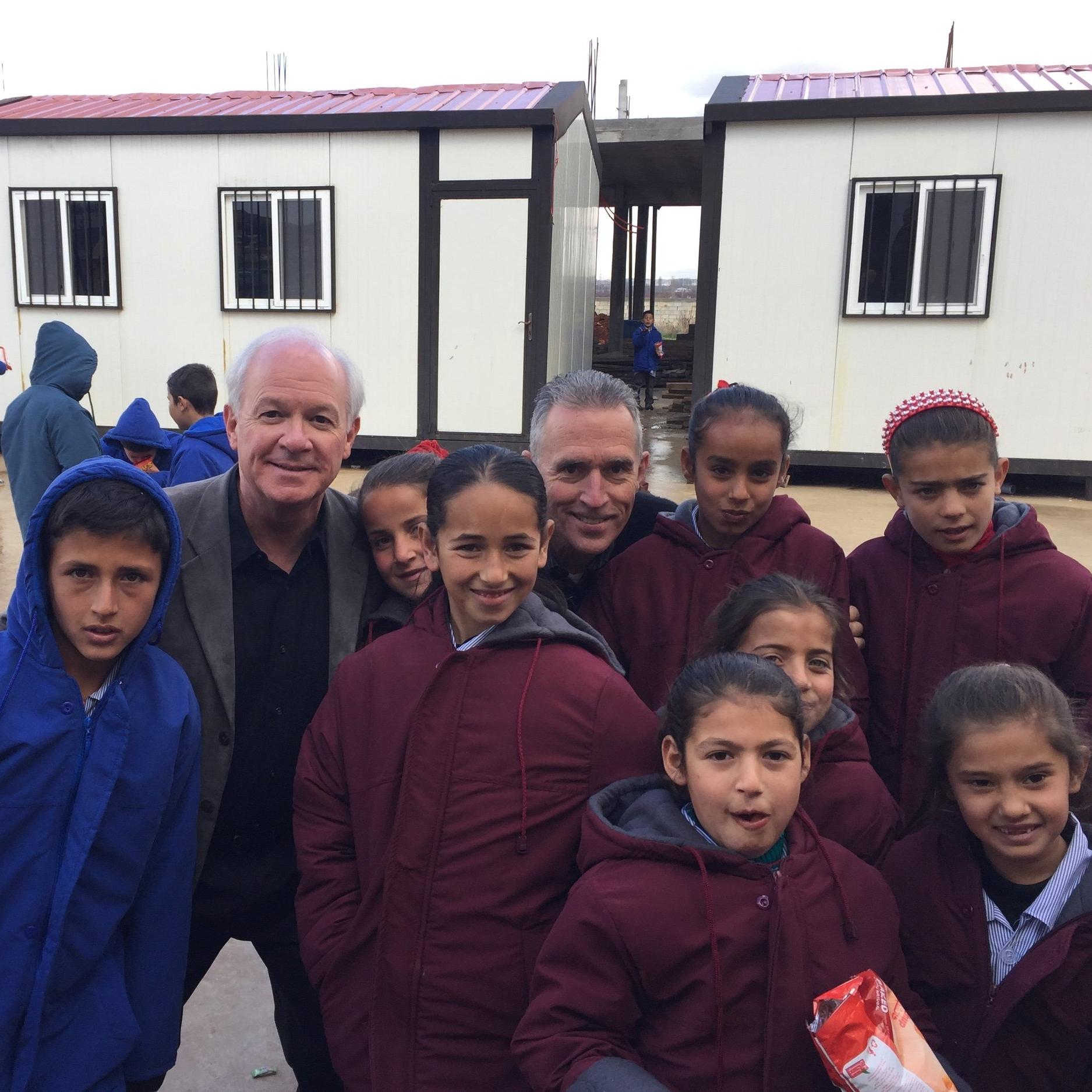 Jack Baca and Mark Mueller make friends in Anjar.