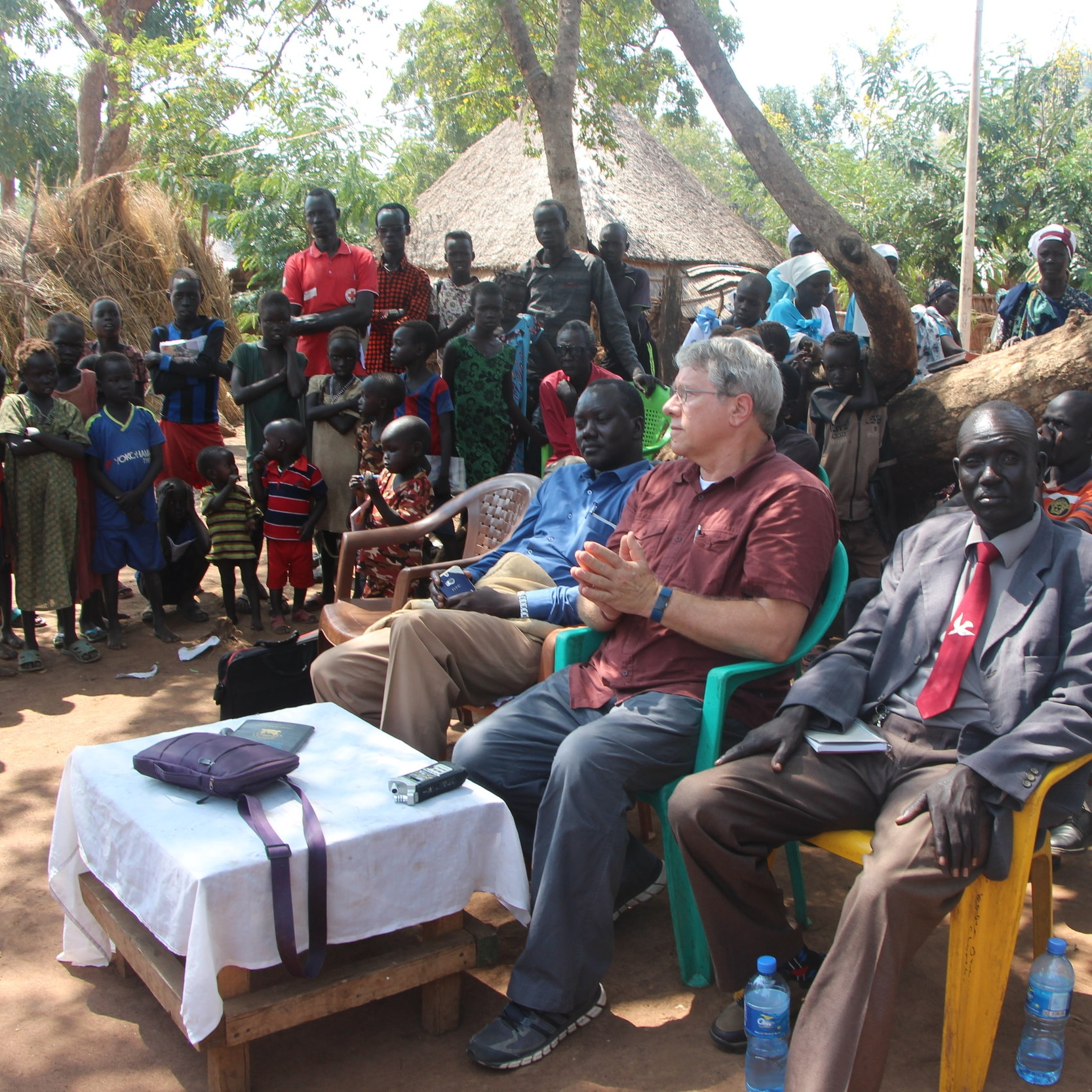 Official welcome to Nguenyiel camp –  Dr. Frank Dimmock is flanked on his left by the Rev. Simon Chan Luak from Nguenyiel and by the Rev. James Gatdet of the Mekane Yesus Church on his right.