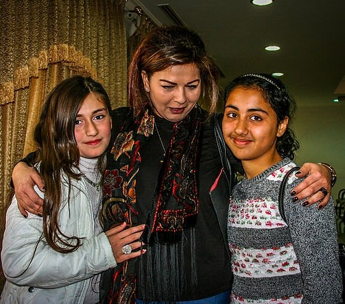Wafa with two young Iraqi Christian refugees