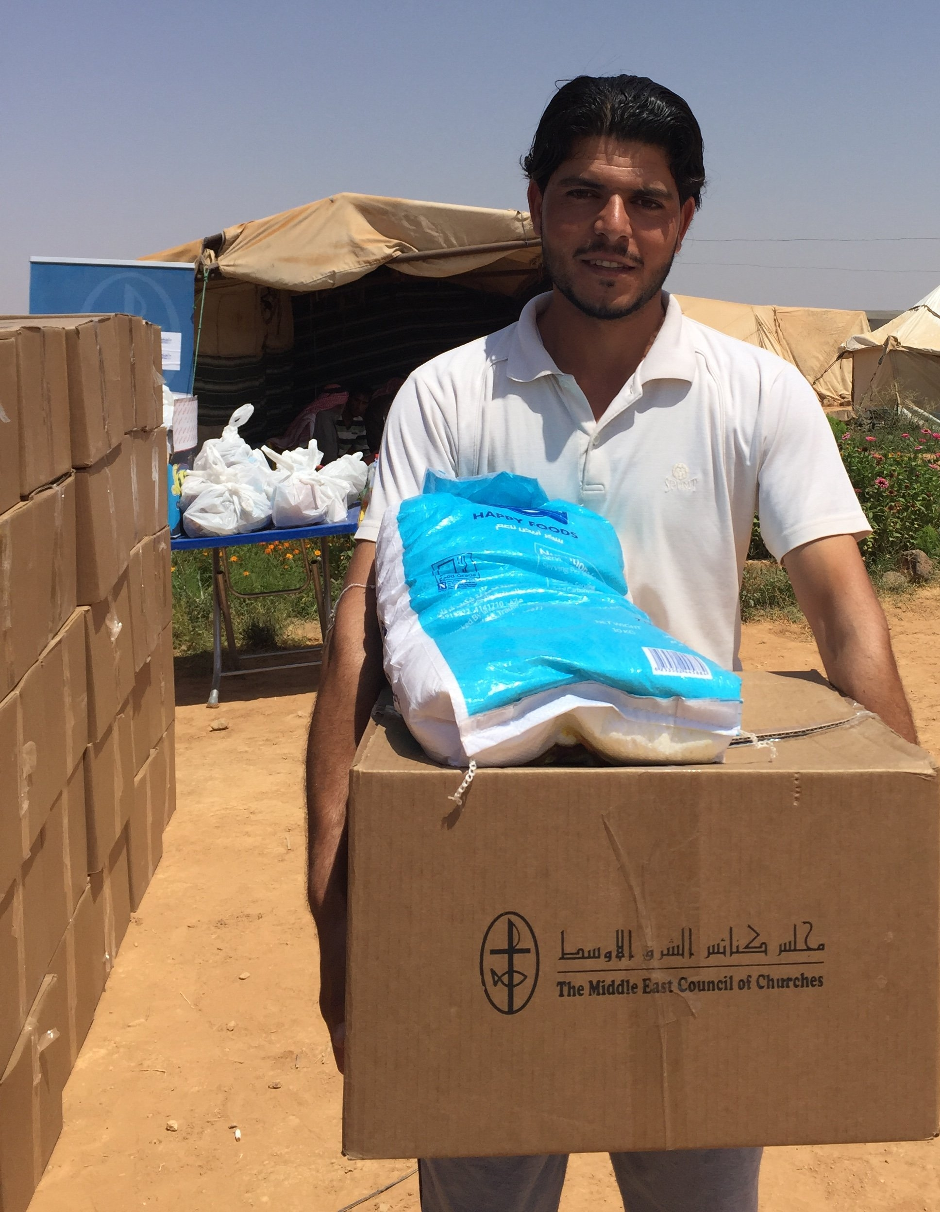 Refugee IDP Appeal March 2018 man with box.JPG