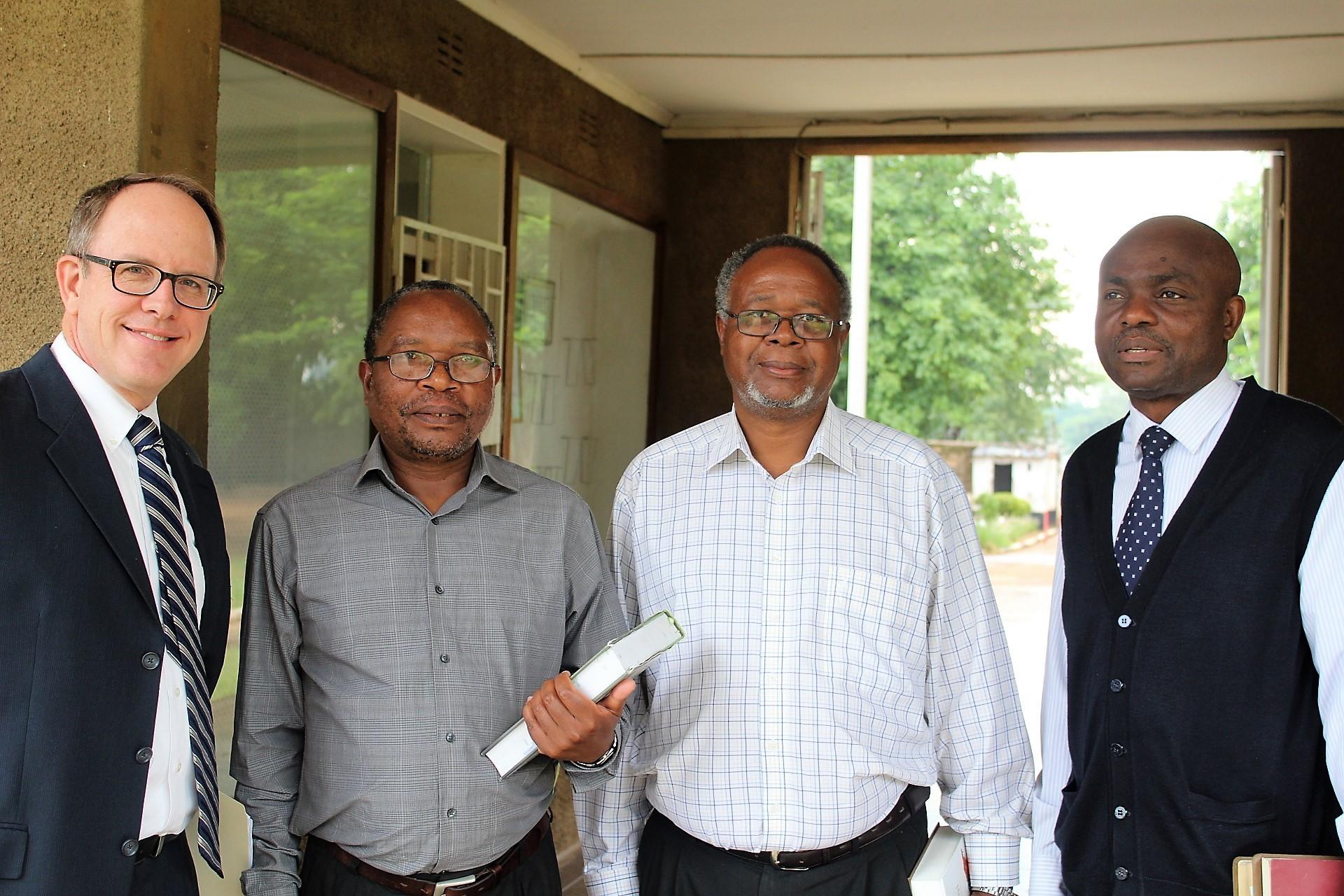 JMU administrative team with JMU lecturer Dr. Dustin Ellington (left to right) – Dustin, Vice Chancellor Dr. Lukas Soko,  Assistant Registrar Dr. Victor Chilenje and  Registrar Dr. Stephen S. Kakungu.