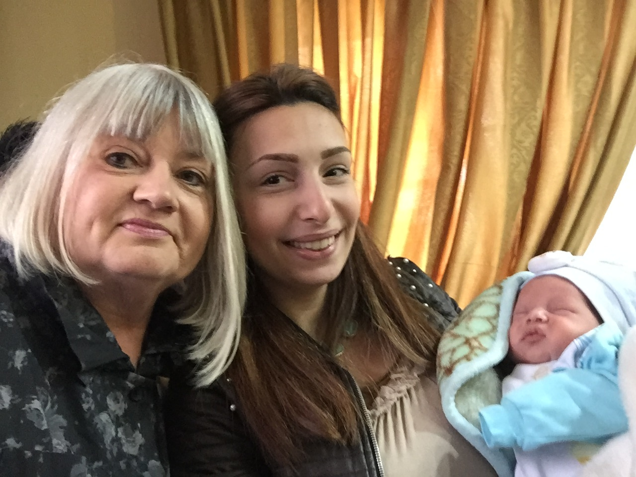 Marilyn Borst meets 25-day old Kahlil, the newest member of Aleppo church