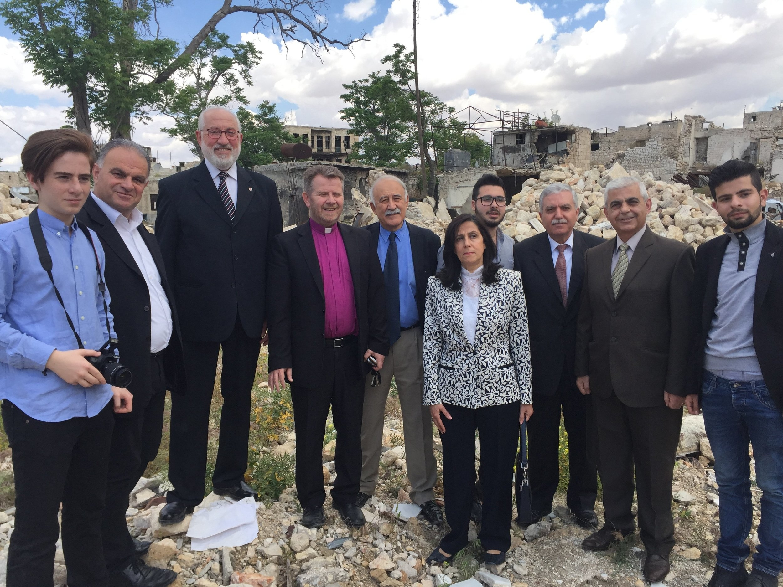 Rev. Ibrahim and his elders atop the rubble of the old church